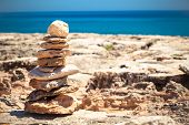 foto of fulcrum  - Stones balance pebbles stack over blue sea - JPG