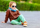 pic of bomber jacket  - stylish boy in leather jacket posing on the ground - JPG