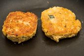 foto of crab-cakes  - Fresh crab cakes browning in hot oil in a pan - JPG