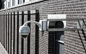 stock photo of cctv  - cctv camera outside of a building in the netherlands - JPG