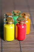 picture of pigment  - Bottles with colorful dry pigments on bamboo mat background - JPG
