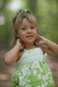 foto of little girls photo-models  - Beautiful little girl outdoors in a blurry bacground