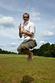 image of pro-life  - A young man with sunglasses is jumping on a meadow - JPG