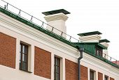 picture of gutter  - Rain gutter and downspout newly installed on historic building - JPG