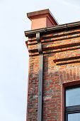 picture of gutter  - Historical building and newly installed modern gutter and drainpipe - JPG