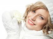 picture of christmas flower  - attractive young caucasian woman in warm clothing  studio shot isolated on white smiling winter rose flower - JPG