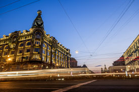 stock photo of fussy  - House Zinger on Nevsky Prospekt in St. Petersburg at night illumination in white nights 13 june 2014