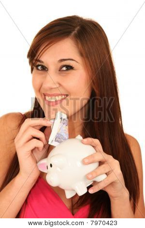 Gorgeous Woman With Piggybank
