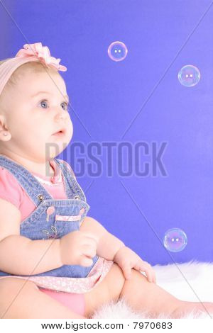 baby amazed with bubbles