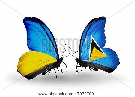 Two Butterflies With Flags On Wings As Symbol Of Relations Ukraine And Saint Lucia