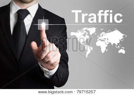 Businessman Pushing Button Traffic World Map
