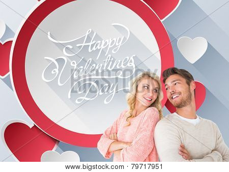 Attractive couple smiling with arms crossed against happy valentines day