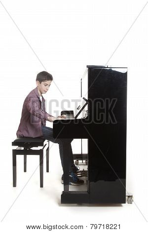 Teenage Boy Plays The Piano In Studio