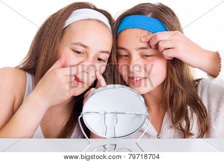 Girls Searching For Blemishes On Theirs Skin
