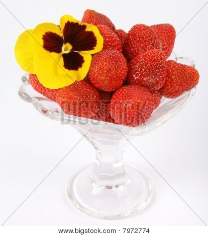 Strawberries  with a yellow pansy
