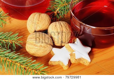 Cinnamon Stars And Walnuts With Tea Cup On A Wooden Table