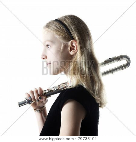 Young Blond Girl Holds Flute In Studio