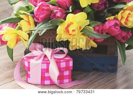 spring flowers with ponk gift box