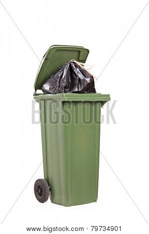 Studio shot of a big green trash can isolated on white background