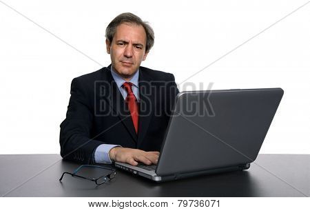 mature business man working with his laptop, isolated