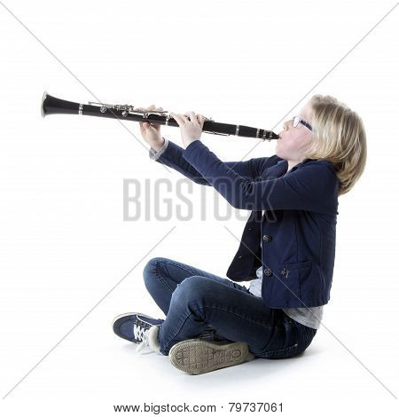 Young Blond Girl In Blue Plays Clarinet In Studio