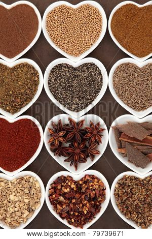 Spice selection in heart shaped porcelain dishes.
