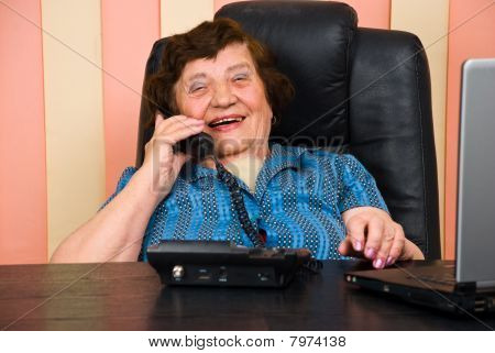 Senior Businesswoman Having Funny Conversation