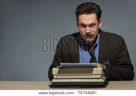Inspired author working at the typewriter