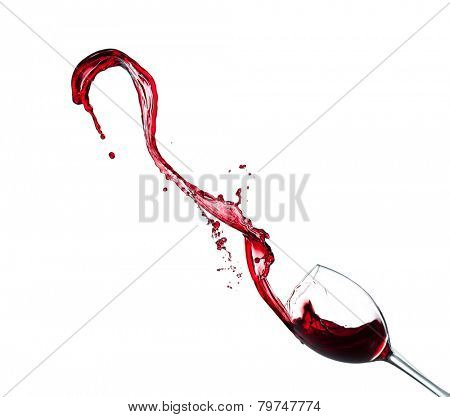 Glass of red wine splashing out, isolated on white background