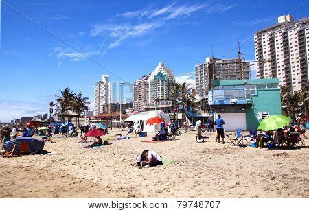 Sunbathers Soaking Up Sun On Durban Beach, South Africa