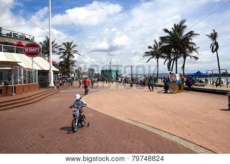 Pedestrians And Cyclists On Promenade, Durban South Africa