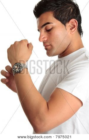Man Putting On Chronograph Watch