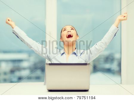 business, technology and office concept - screaming businesswoman with laptop in office