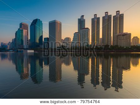 Bangkok city downtown sunrise with reflection of skyline