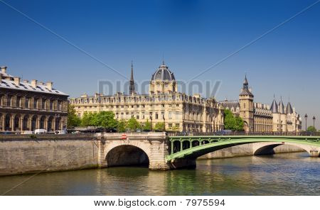 View Of Palais De Justice And A Bridge Over The Seine River. Paris, France.