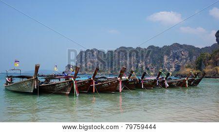 Row of Long Tail boats at Railay Bay, Thailand.