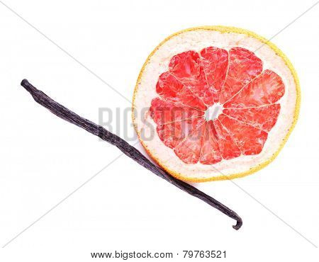 Dried grapefruit with vanilla bean isolated on white