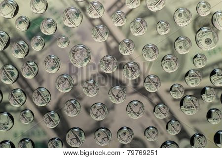 Dollars In Water Droplets