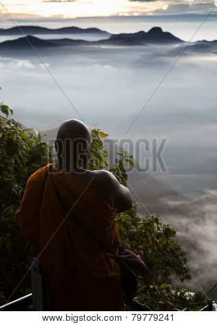 ADAM'S PEAK, SRI LANKA - JANUARY 6: Buddhist monk at Buddhist monastery on the top of Adam's Peak on january 6, 2015 expecting the sun to worship on Central Highland, Sri Lanka.