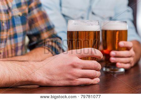 Drinking Beer At The Bar.