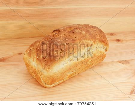 Freshly Baked Loaf Of Oat And Linseed Bread