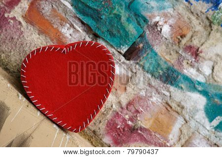 Heart shape on old brick wall background