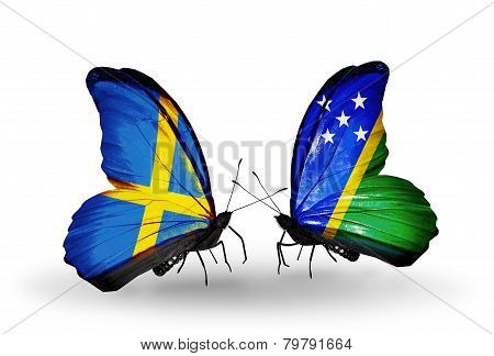 Two Butterflies With Flags On Wings As Symbol Of Relations Sweden And Solomon Islands
