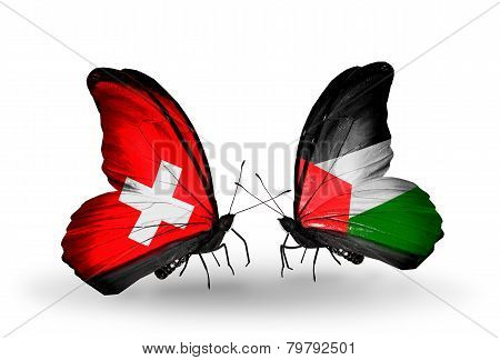 Two butterflies with flags on wings as symbol of relations Switzerland and Palestine
