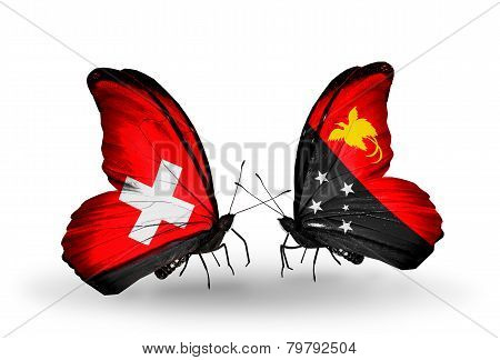 Two butterflies with flags on wings as symbol of relations Switzerland and Papua New Guinea