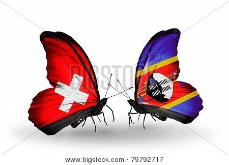 Two butterflies with flags on wings as symbol of relations Switzerland and Swaziland
