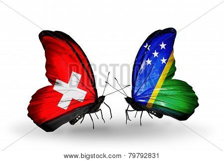 Two Butterflies With Flags On Wings As Symbol Of Relations Switzerland And Solomon Islands