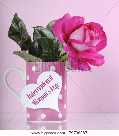 Happy International Womens Day Greeting With Pink Rose And Polka Dot Coffee Mug On Pink Background W