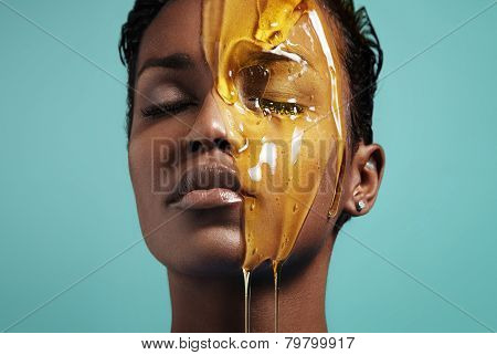 Closeup Portrait Of A Black Woman With A Honey On Her Face