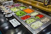 picture of buffet lunch  - salad bar with vegetables in the restaurant healthy food - JPG